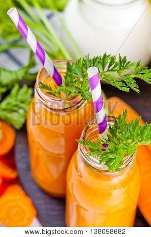 Carrot orange smoothie. Healthy lifestile. Green concept.