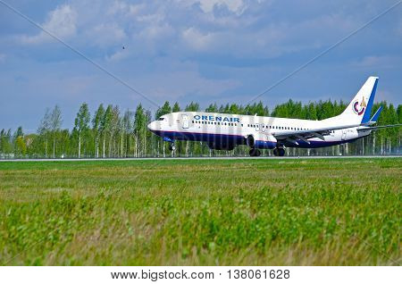 ST PETERSBURG RUSSIA - MAY 11 2016. VO-BCJ Orenair Airlines Boeing 737-800 airplane closeup. Airplane lands on the runway in Pulkovo International airport in St Petersburg Russia
