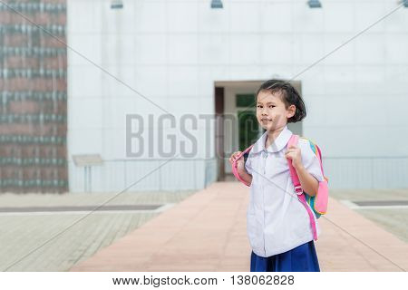 Asian girl kid student in uniform going to school. Student back to school concept.