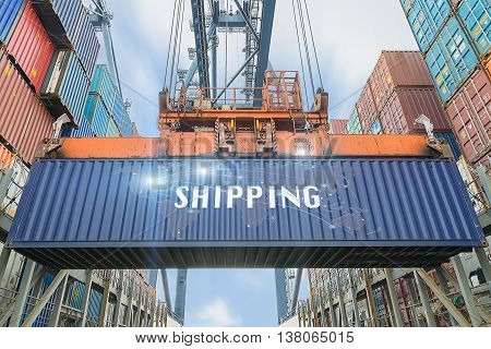 Loading containers box from cargo freight ship with big crane use for importexportLogistics background.(Elements of this image furnished by NASA)