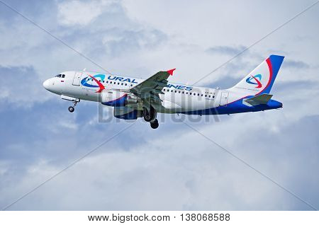 ST PETERSBURG RUSSIA-MAY 11 2016. VQ-BTY Ural Airlines Airbus A319 airplane closeup view. Airplane is flying in the sky after departure from Pulkovo airport in St Petersburg