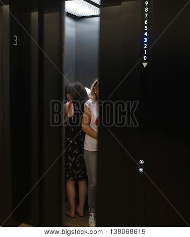 LONDON,UK - JULY 06, 2016: People in elevator waiting while doors are closing in New Tate building, London.