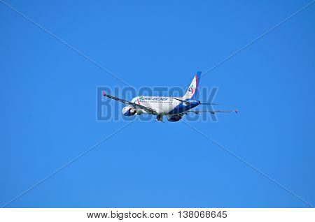ST PETERSBURGRUSSIA-MAY 11 2016. VQ-BTY Ural Airlines Airbus A319 airplane closeup view. Airplane is flying in the sky after departure from Pulkovo airport in St Petersburg