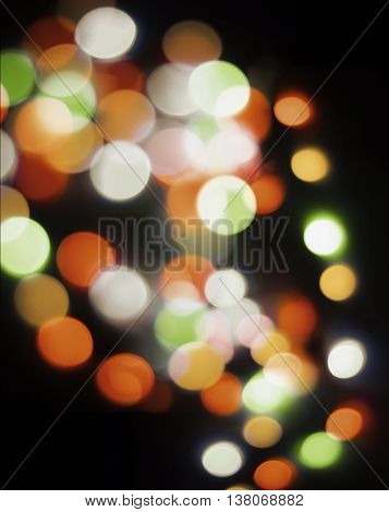 bokeh in orange and green colors for xmas