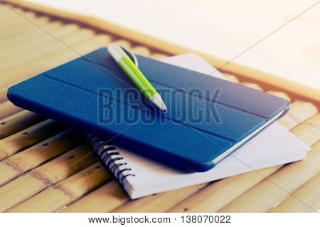notepad,tablet,pen on wood background,office view images by category