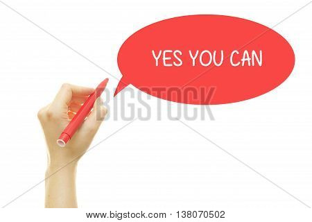 Woman hand writing YES YOU CAN with a marker isolated on white.