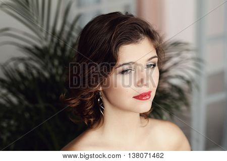 Lovely girl with red lipstick and curly hair