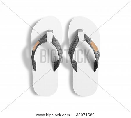Pair of blank white slippers, design mockup, clipping path. Home plain flops mock up template top view. Clear bath sandal display. Bed shoes accessory footwear. Rubber beach flip-flops.