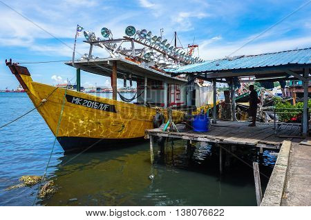 Labuan,Malaysia-July 11,2016:Fishing boats and trawlers moor at the jetty after returning from sea at Labuan Pearl of Borneo.The fishing industry contributes a significant income to islanders here.