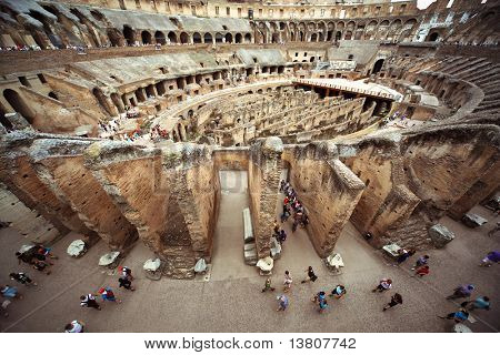 People on first circle of arena in ancient Coliseum in Rome, Italy at sunny day
