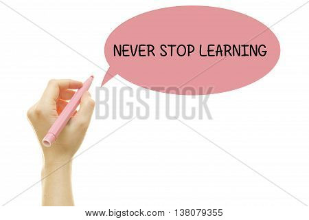 Woman hand writing NEVER STOP LEARNING with a marker isolated on white.