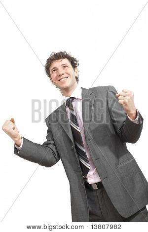 Happy young businessman celebrating business success with fists clenched, smiling.  Isolated on white.?