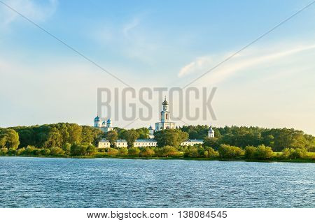 Summer architecture panoramic view -architecture ensemble of Yuriev monastery on the bank of Volkhov river in Veliky Novgorod Russia sunset summer architecture view of architecture Orthodox landmark