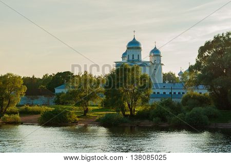 Architecture sunset summer landscape - St George cathedral of Yuriev monastery near the Volkhov river in Veliky Novgorod Russia. Sunset summer architecture view in backlight