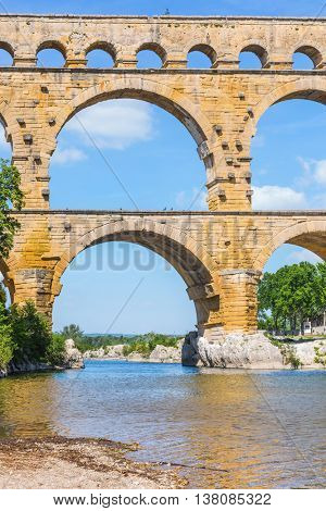 Part of the bridge. Three-tiered aqueduct Pont du Gard - the highest in Europe. Provence, spring sunny day