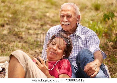 Husband And Wife Senior Man Woman Listening Music