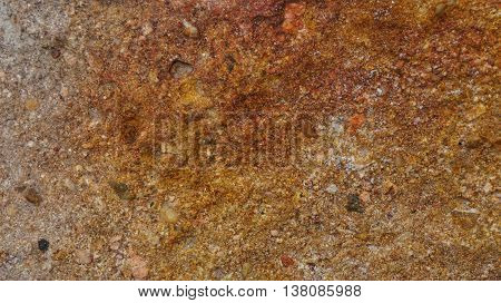Rough brown stone background. Abstract irregular minerals.