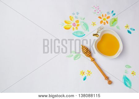 Jewish holiday Rosh Hashana background with honey and watercolor drawings. View from above. Flat lay
