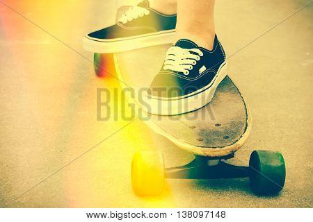 Woman skateboarding with light leaks