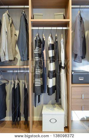 Row Of Black Dress,shirts And Pants Hang In Wardrobe