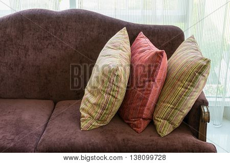 Colorful Striped Pillows On Red Sofa In Luxury Living Room Interior
