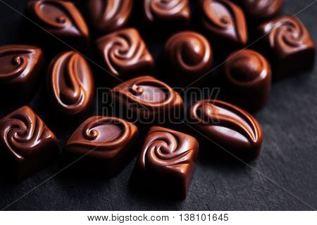 Chocolate Candy Sweets in high resolution. Dark chocolate stack, chips and powder. Set of candies collection.