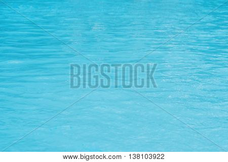 Water in swimming pool  with shiny light reflection
