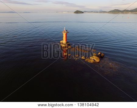 lighthouse in the sea, calm sea on a clear day