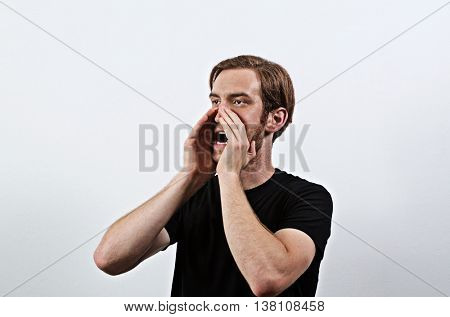 Shouting Young Adult Male in Dark T-Shirt