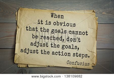 Ancient chinese philosopher Confucius quote on old paper background.	When it is obvious that the goals cannot be reached, don't adjust the goals, adjust the action steps.