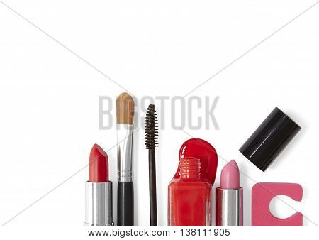 A selection of make up products isolated on a white background, forming a page footer