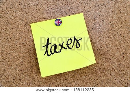 Yellow Paper Note Pinned With Great Britain Flag Thumbtack And Text Taxes