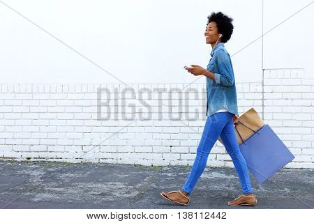 Walking With Shopping Bags And Listening To Music