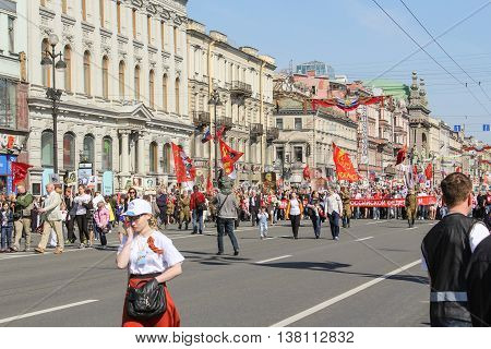 St. Petersburg, Russia - 9 May, People in uniform with a big red flag, 9 May, 2016. Memory Action