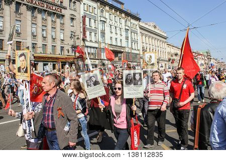 St. Petersburg, Russia - 9 May, Woman with portraits of loved ones, 9 May, 2016. Memory Action