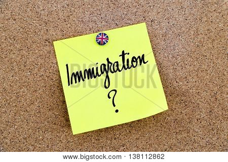 Yellow Paper Note Pinned With Great Britain Flag Thumbtack And Text Immigration