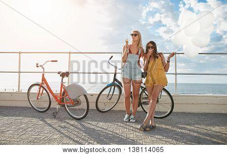Best Friends Enjoying A Holiday On Seaside Promenade