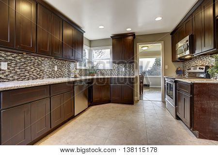 Modern Kitchen Interior With Dark Brown Storage Cabinets