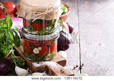 Salted tomatoes with herbs and garlic preserved vegetables