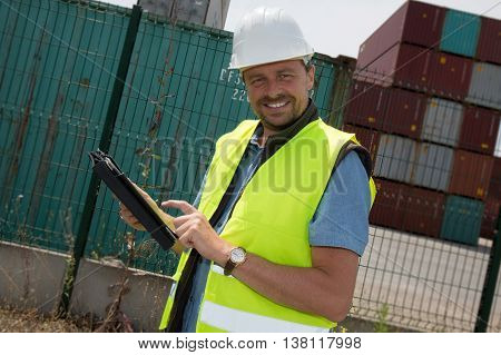 Happy Man Logistics Manager At Container Transhipment Plant, With Tablet