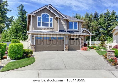 Home Exterior With Garage And Driveway