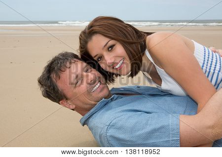 Happy Honeymooners Enjoying Their Vacation On Beach