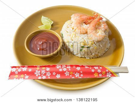 Food and Cuisine A Plate of Shrimp Fried Rice Served with Tomato Sauce and Lime Slice Isolated on White Background.