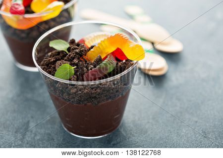 Children chocolate pudding dessert in a cup called dirt and worms