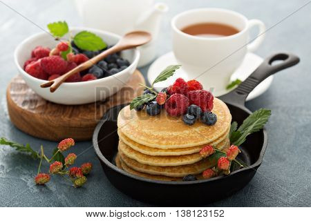 Fluffy buttermilk pancakes with fresh berries for breakfast