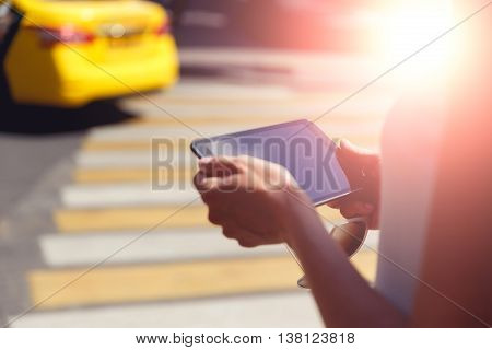 Female hands closeup holding sunglasses and modern tablet. Image with lens flare effect