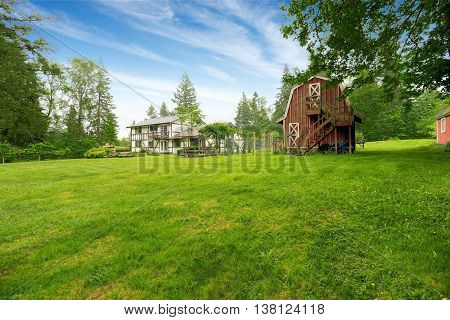 Home Garden On Backyard With Red Barn Shed