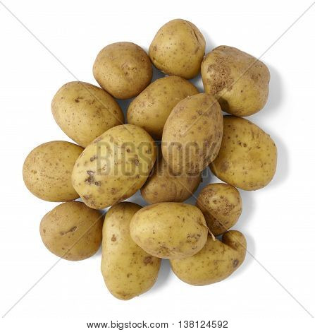 A pile of uncooked baking potatoes isolated on a white background