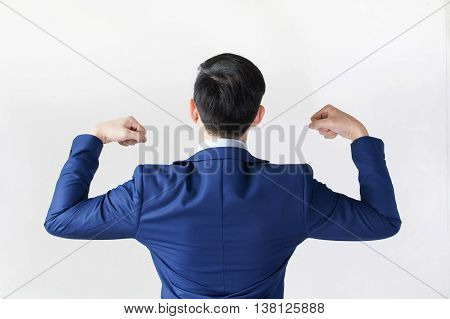 Strong Businessman Flexing His Muscle For Fight And Motivation.