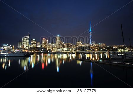 New Zealand's biggest city at night time with beautiful still water